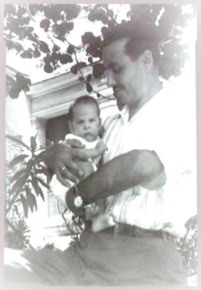 Photo of my dad holding me in his arms in Havana, Cuba. I was just an infant.